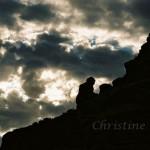 Monk praying on Camelback mountain in Phoenix